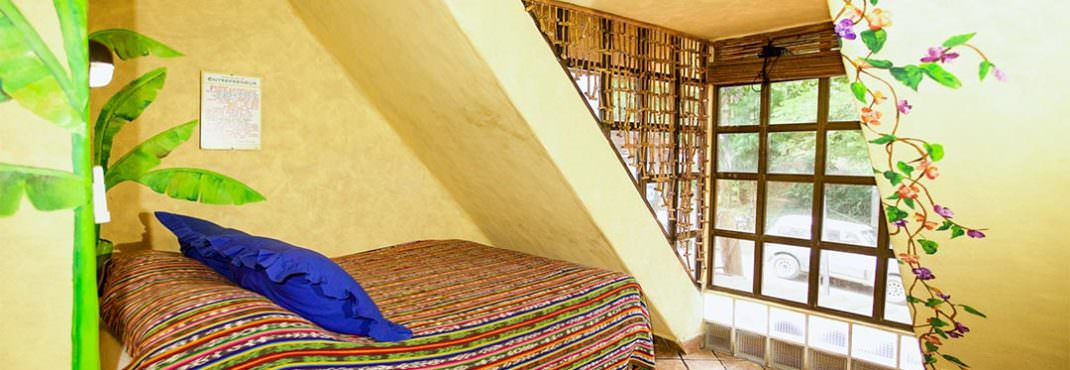 El Sano Banano Village Hotel Room queen plus single bed room with large view
