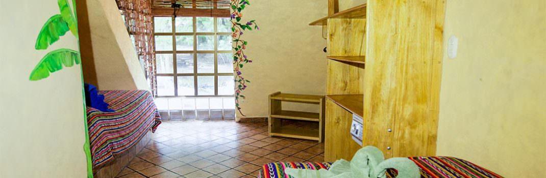 El Sano Banano Village Hotel Room with queen single bed