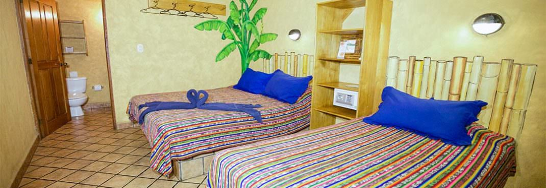 El Sano Banano Village Hotel Room with queen and single beds